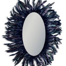 LARGE OVAL MIRROR FRAMED BY BLACK FEATHERS